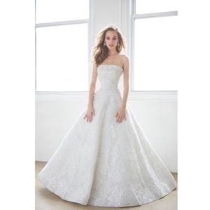 White Strapless Gown With Full Skirt